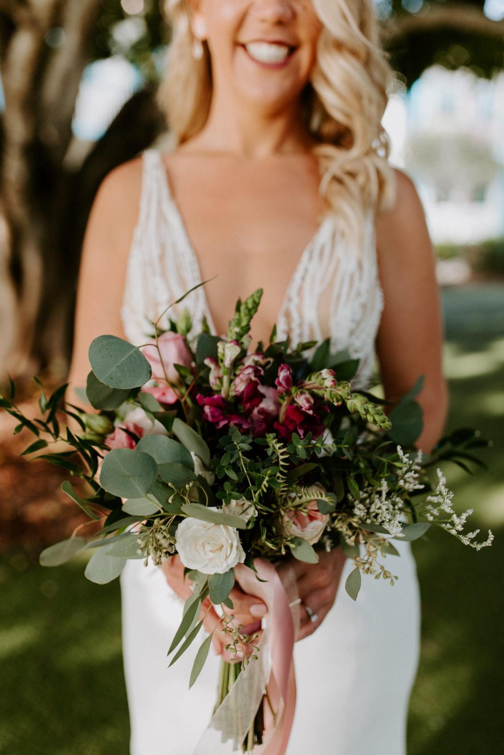 Tampa Bride Holding Wild Greenery Eucalyptus with Purple Flowers Wedding Bouquet