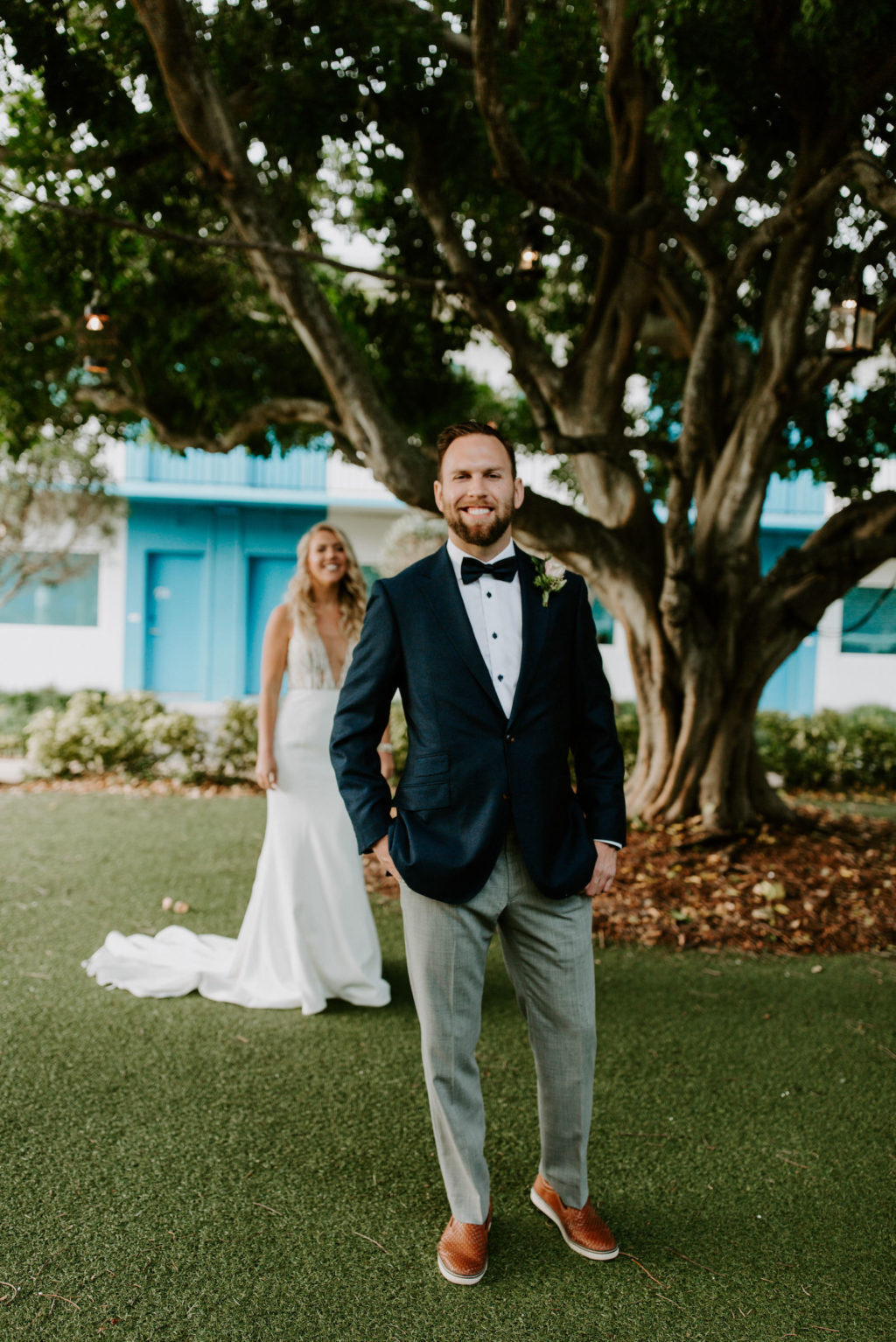 Tampa Bay Bride and Groom in Emerald Green Tuxedo Jacket and Bowtie First Look Photo   St. Pete Beach Wedding Venue Postcard Inn on the Beach