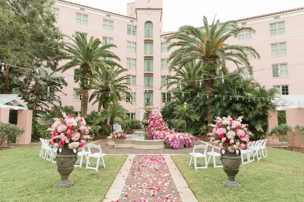 Elegant Garden Wedding Ceremony Decor, Lush Pink and Purple Flowers in Water Fountain and Floral Arrangements, String Lights | St. Pete Wedding Venue The Vinoy Renaissance