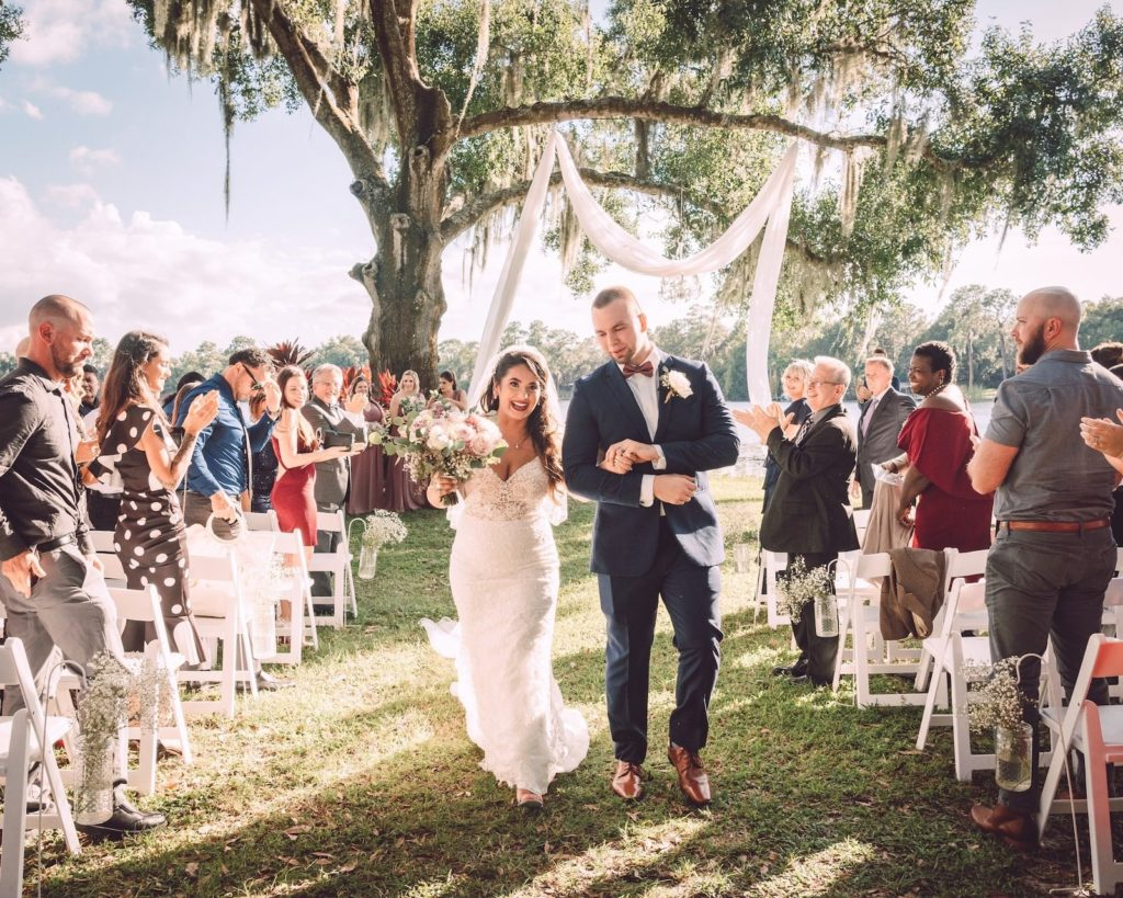 Florida Waterfront Shabby Chic Bride and Groom Recessional Walking Out of Wedding Ceremony | Tampa Bay Wedding Photographer Bonnie Newman Creative | Wedding Dress Shop Truly Forever Bridal | Odessa Wedding Venue Barn at Crescent Lake