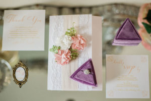 Lace and Blush Wedding Invitation with Floral Detail   Halo Engagement Ring in Purple Velvet Ring Box