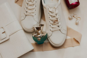 White Sneakers, Versace Perfume Bottle, Yellow Gold Oval Diamond Engagement Ring