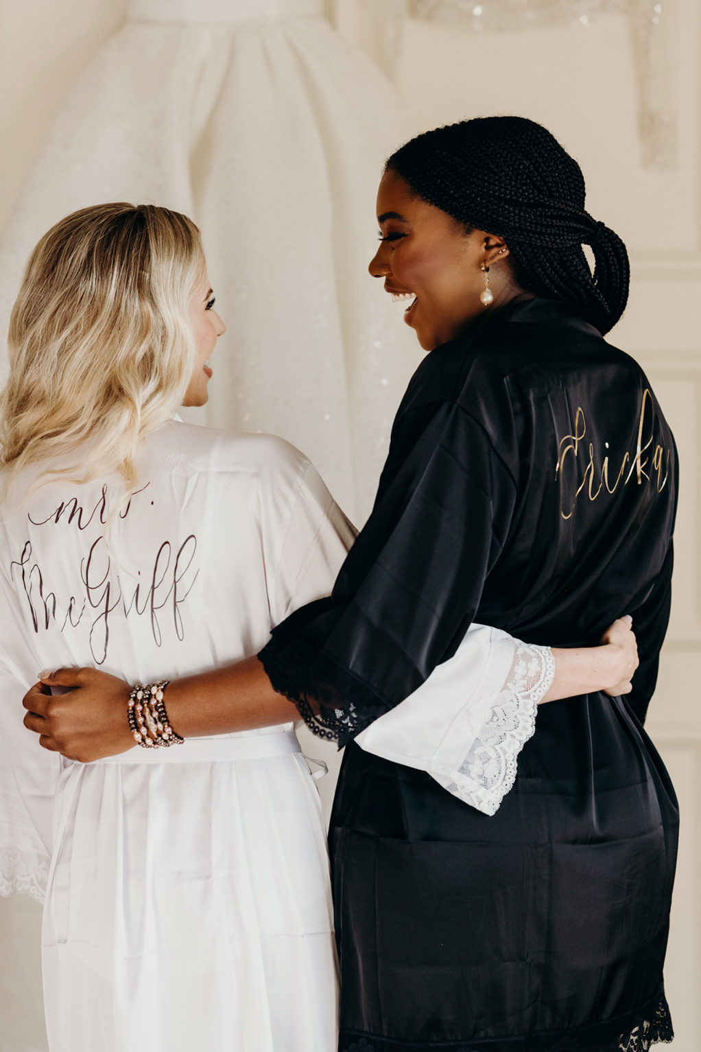 Bride in White Personalized Robe and Bridesmaids in Black Robe