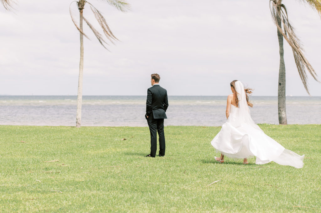 Outdoor Waterfront Bride Behind Groom First Look | Tampa Bay Wedding Photographer Kera Photography