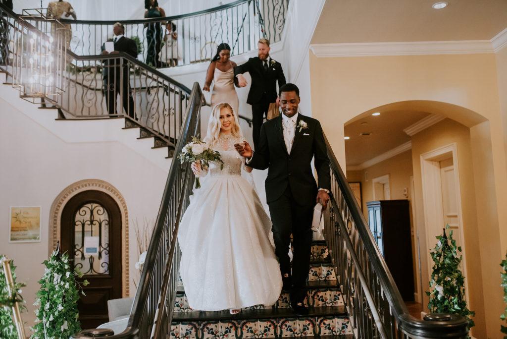 Timeless Elegant Bride and Groom Walking Down Staircase at Tampa Bay Wedding Venue Westshore Yacht Club