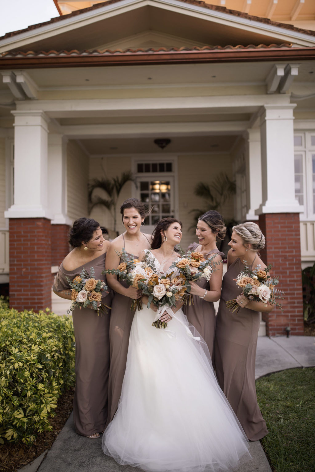 Bridesmaids in Neutral Taupe Mix and Match Bridesmaid Dresses Next to the Bride Portrait   Bohemian Inspired Floral Bouquets with Burnt Orange, Cream and Greenery   Paloma Blanca, Overskirt: Hayley Paige   Bridesmaids in Show Me Your MuMu