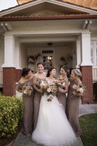 Bridesmaids in Neutral Taupe Mix and Match Bridesmaid Dresses Next to the Bride Portrait | Bohemian Inspired Floral Bouquets with Burnt Orange, Cream and Greenery | Paloma Blanca, Overskirt: Hayley Paige | Bridesmaids in Show Me Your MuMu