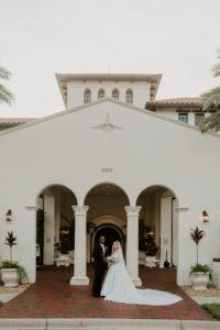 Timeless Elegant Bride and Groom Outside Tampa Bay Wedding Venue Westshore Yacht Club