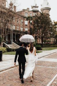 Bride and Groom Wedding Portrait with Rain Umbrella | University of Tampa Wedding Photo Inspiration