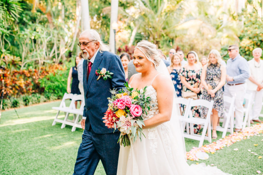 Father Walking his Daughter Down the Wedding Ceremony Aisle | Bride in Nikki's Glitz and Glam - Morilee by Madeline Gardner | Bright Colored Wedding Bouquet