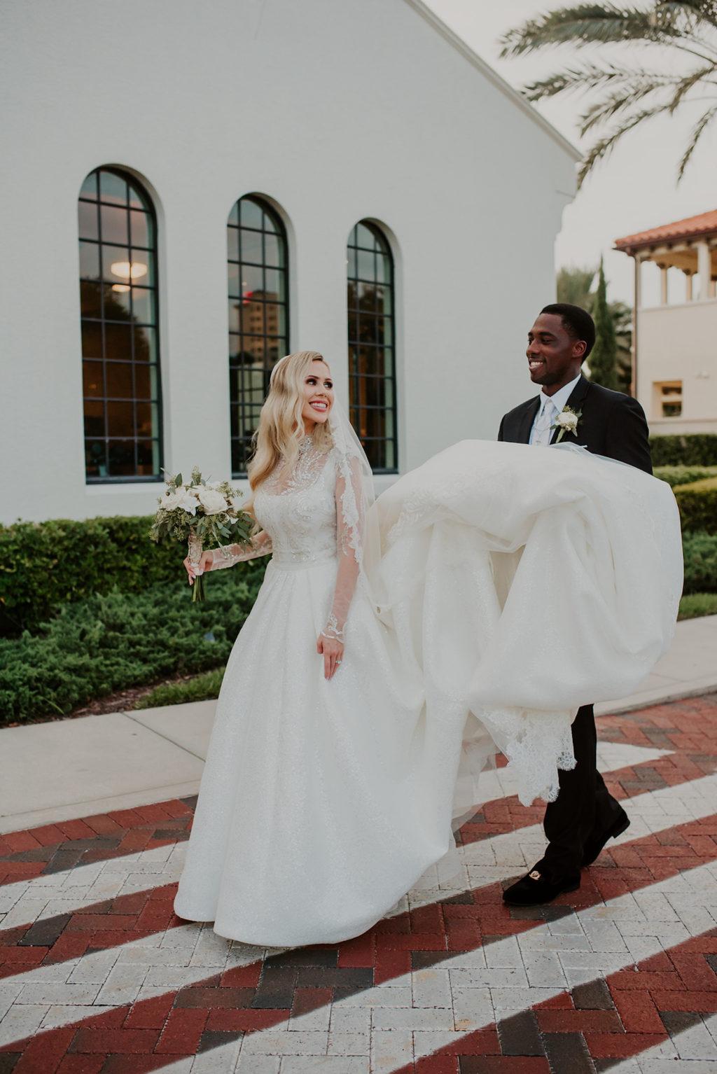 Timeless Elegant Bride and Groom Holding Wedding Dress Train   Tampa Bay Wedding Venue Westshore Yacht Club