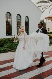 Timeless Elegant Bride and Groom Holding Wedding Dress Train | Tampa Bay Wedding Venue Westshore Yacht Club