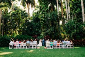 Tropical Florida Garden Wedding Ceremony with White Chairs | St. Petersburg Wedding Venue Sunken Gardens