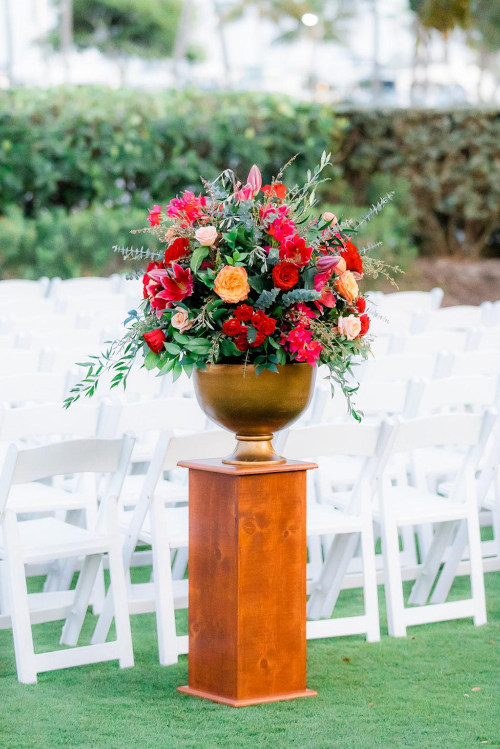 Elegant Wedding Ceremony Decor, Tall Wooden Pedestal, Gold Vase with Jewel Tone Red, Orange, Pink Roses Greenery Floral Arrangement