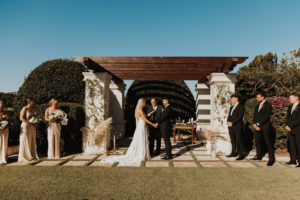 Timeless Bride and Groom Exchanging Wedding Vows Under Outdoor Pergola   Tampa Wedding Venue The Concession Golf Course