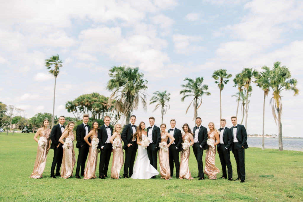 Wedding Party Group Photo | Bridesmaids in Matching One Shoulder Rose Gold Sequin Dresses, Groomsmen in Black Tuxedos, Bride and Groom | Tampa Bay Wedding Photographer Kera Photography