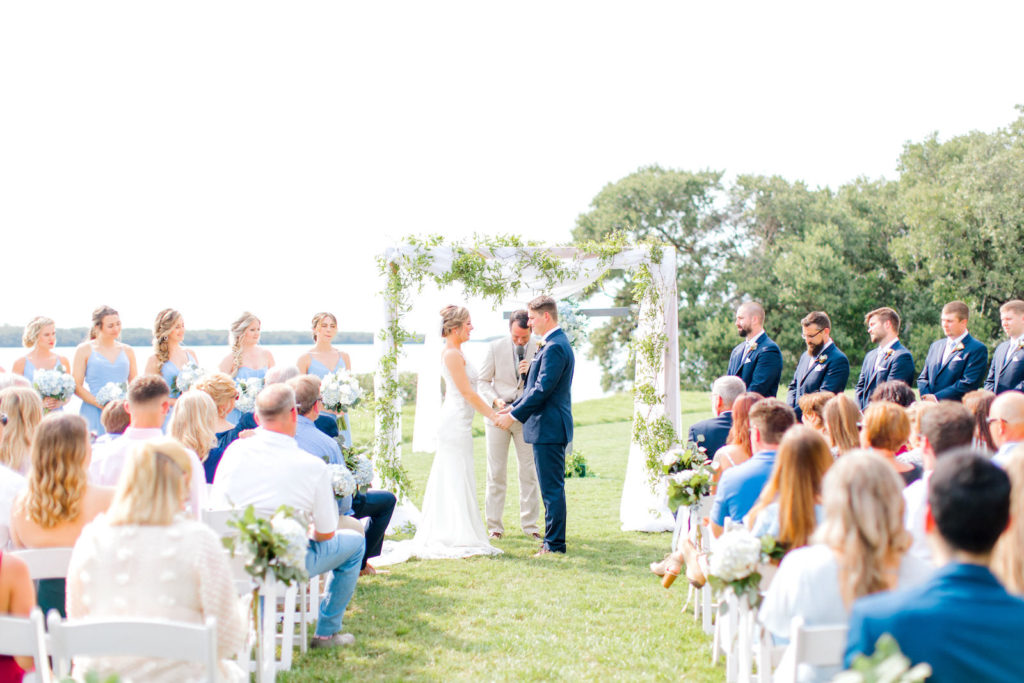 Waterfront Wedding Ceremony with Greenery Draped Arch   St. Petersburg Wedding Planner Special Moments Event Planning   Venue Tampa Bay Watch