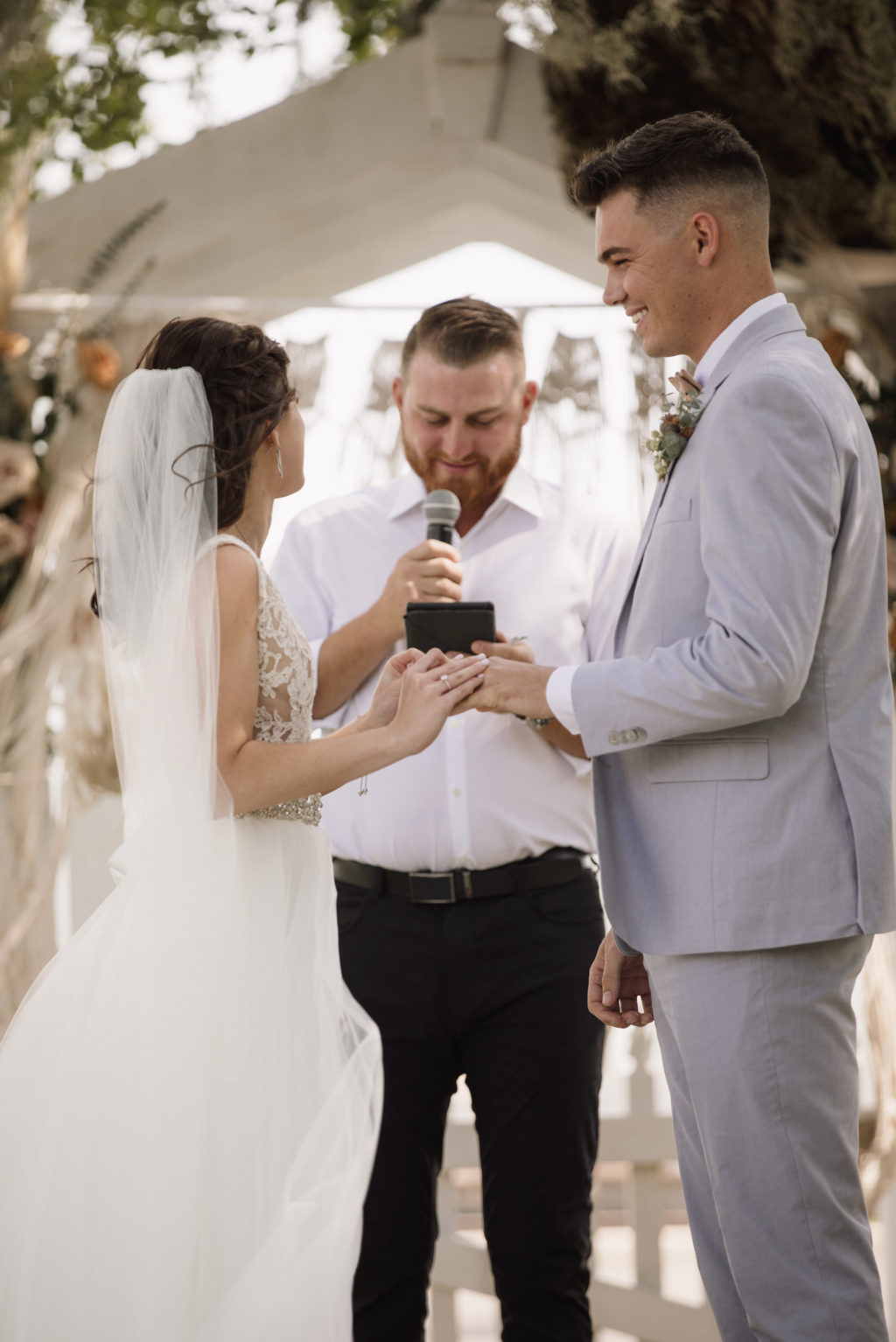Bride and Groom Exchange Vows at Intimate Wedding Ceremony In Front of Wedding Officiant   Florida Wedding Ceremony