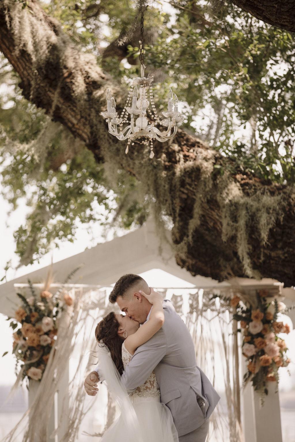 Bride and Groom First Kiss at Bohemian Wedding Ceremony   Florida Waterfront Wedding Ceremony   Sarasota Wedding Photographer Alisa Sue Photography