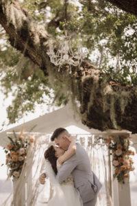 Bride and Groom First Kiss at Bohemian Wedding Ceremony | Florida Waterfront Wedding Ceremony | Sarasota Wedding Photographer Alisa Sue Photography