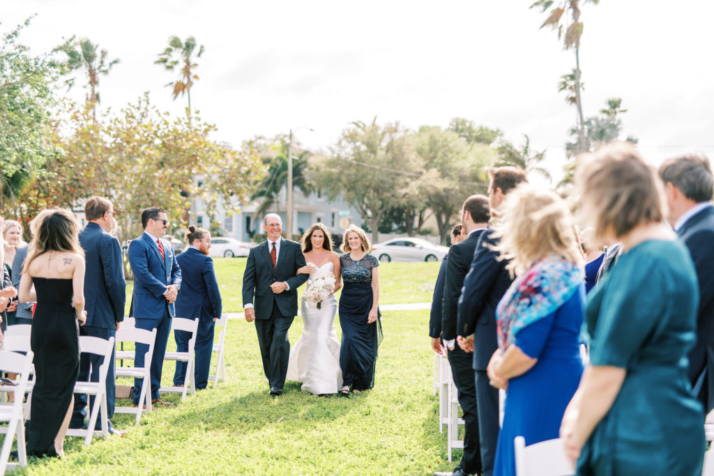 Florida Bride Walking Down the Wedding Ceremony Aisle with Mom and Dad | Tampa Bay Wedding Photographer Kera Photography