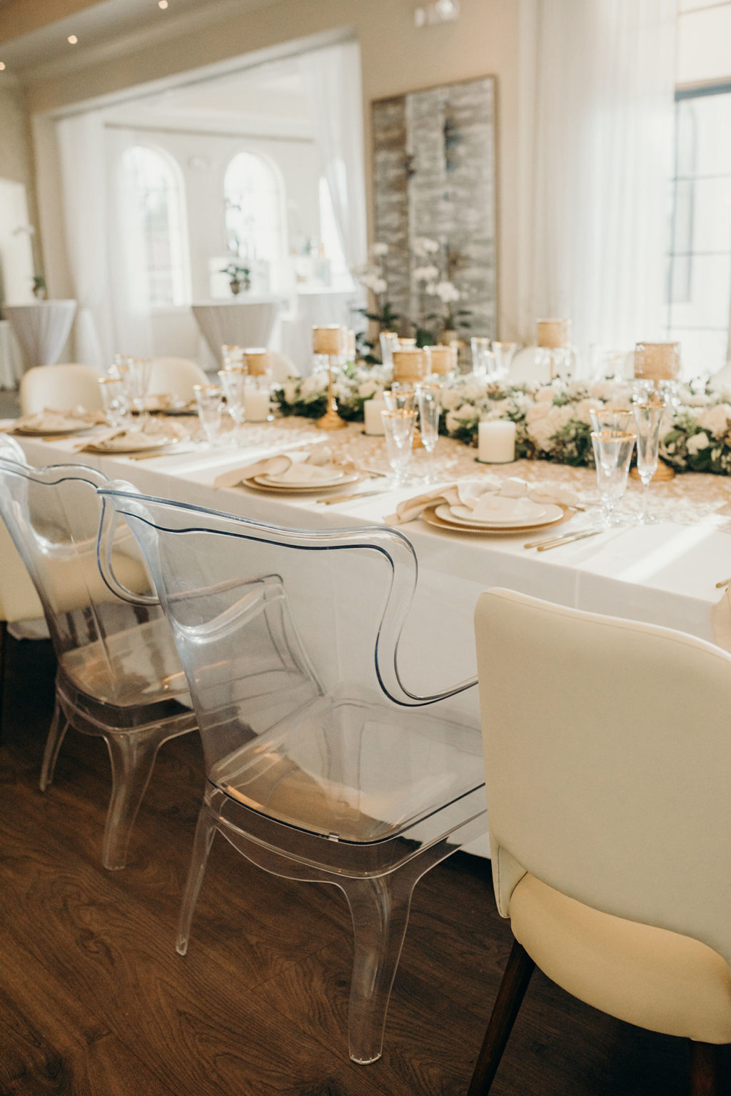 Timeless Elegant Wedding Reception Decor, Long Feasting Table, Acrylic Chairs, White Roses and Greenery Garland, Candlesticks, Gold Chargers | Tampa Bay Wedding Venue Westshore Yacht Club