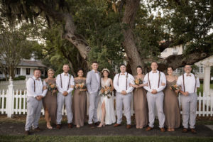 Wedding Bridal Party Bridesmaids in Taupe and Groomsmen's in Gray and Groomsmen in Suspenders and Bowties Wedding Portrait | Bridesmaids Dresses Show Me Your MuMu