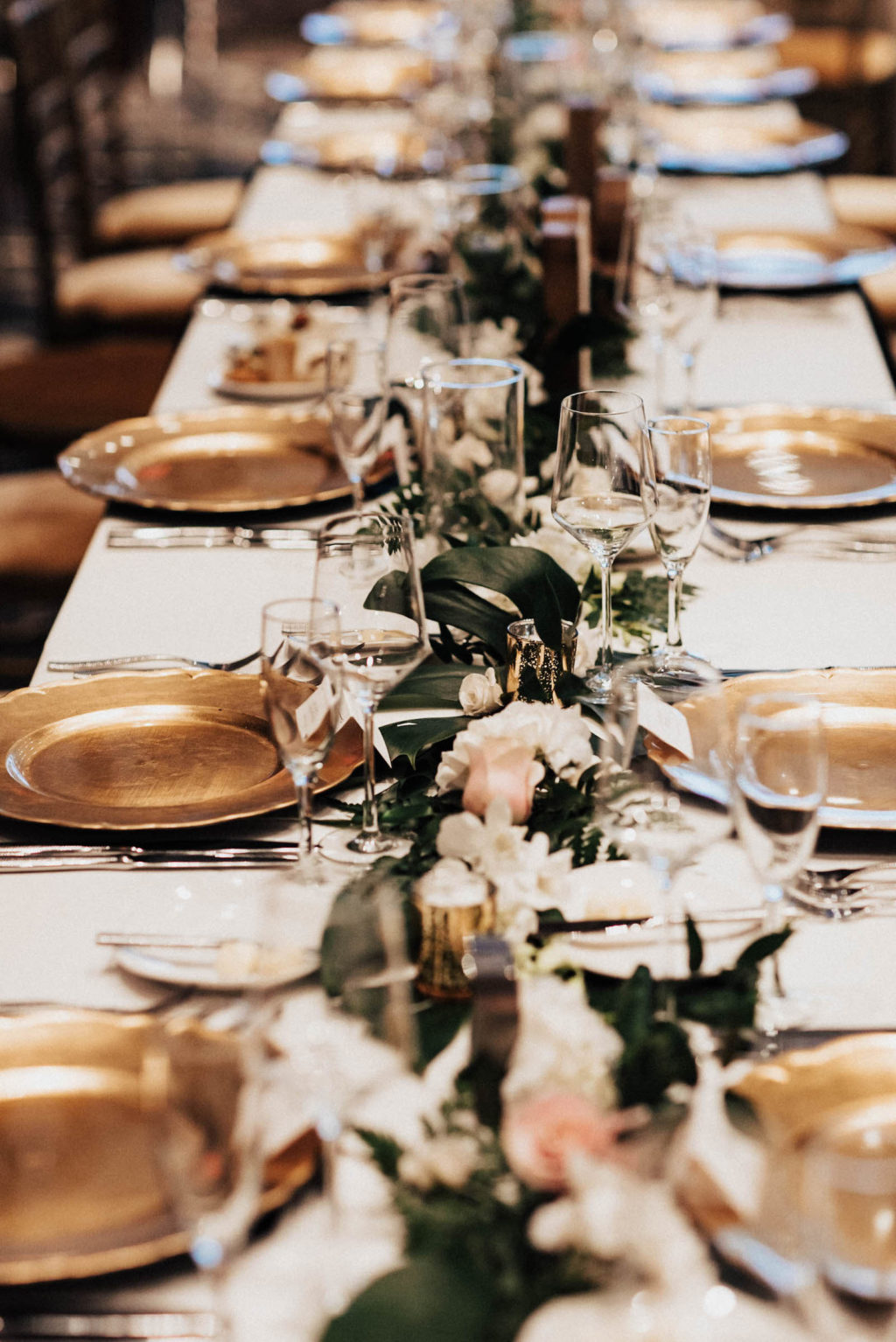 Gold Chargers with Floral and Greenery Centerpieces for Wedding Feasting Tablescape | Tampa Bay Rental Company Kate Ryan Event Rentals