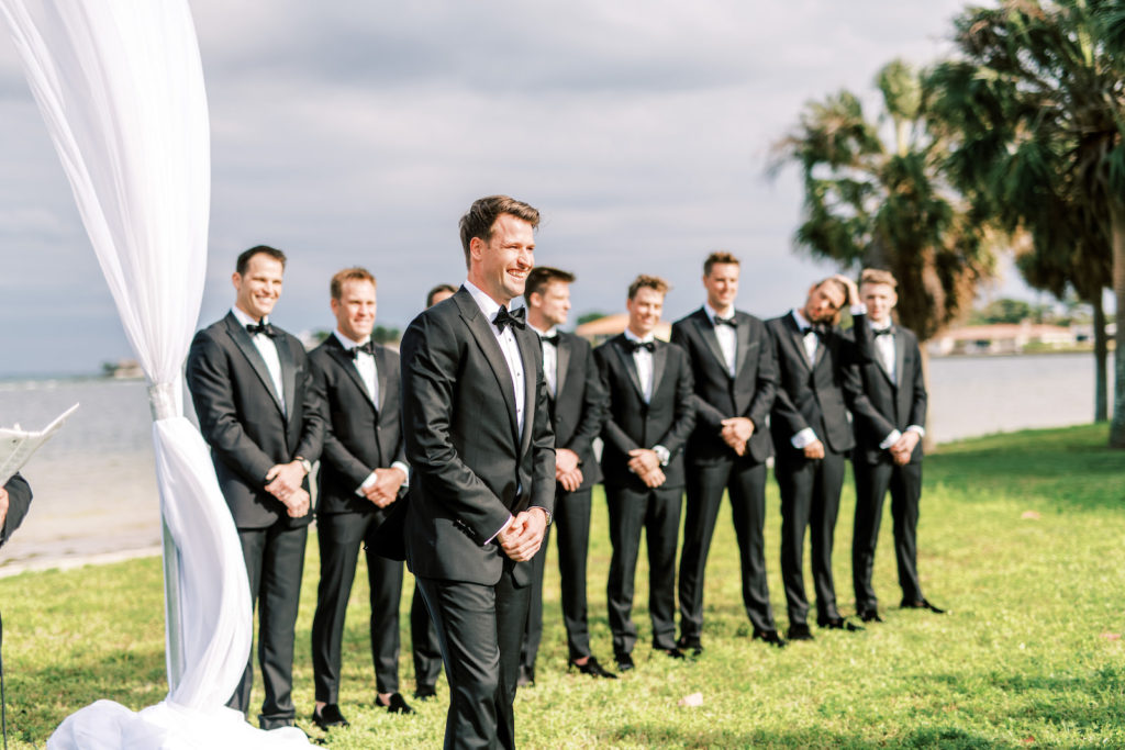 Florida Groom Reaction to Watching Bride Walking Down the Wedding Ceremony Aisle | Tampa Bay Wedding Photographer Kera Photography | Outdoor Waterfront Wedding Venue Lassing Park