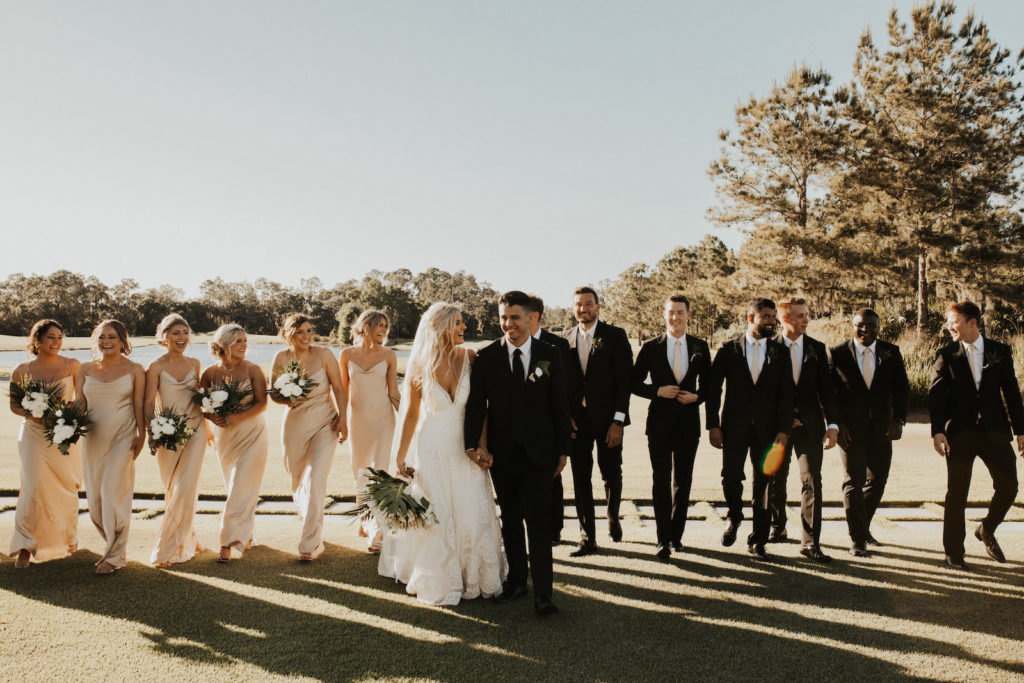 Timeless Neutral Bride, Groom,Bridesmaids in Silky Matching Champagne Gold Dresses and Groomsmen in Black Suits