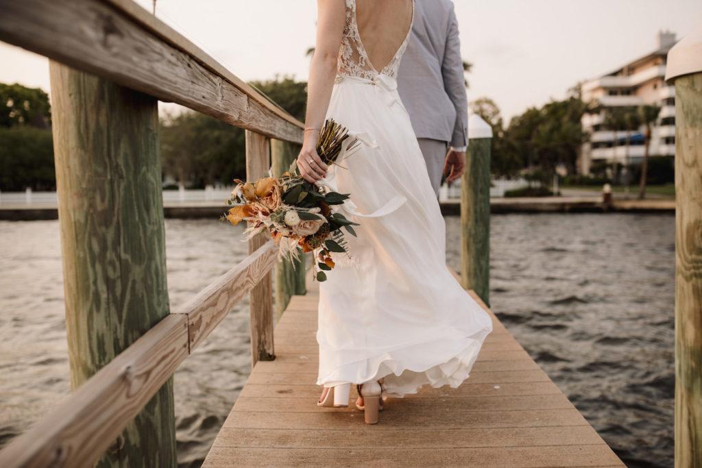 Florida Bride and Groom Wedding Walking Down Waterfront Pier   Photographer Alisa Sue Photography