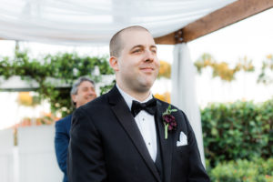 Florida Groom Reaction to Bride Walking Down the Wedding Ceremony Aisle Wearing Black Tuxedo with Bow Tie