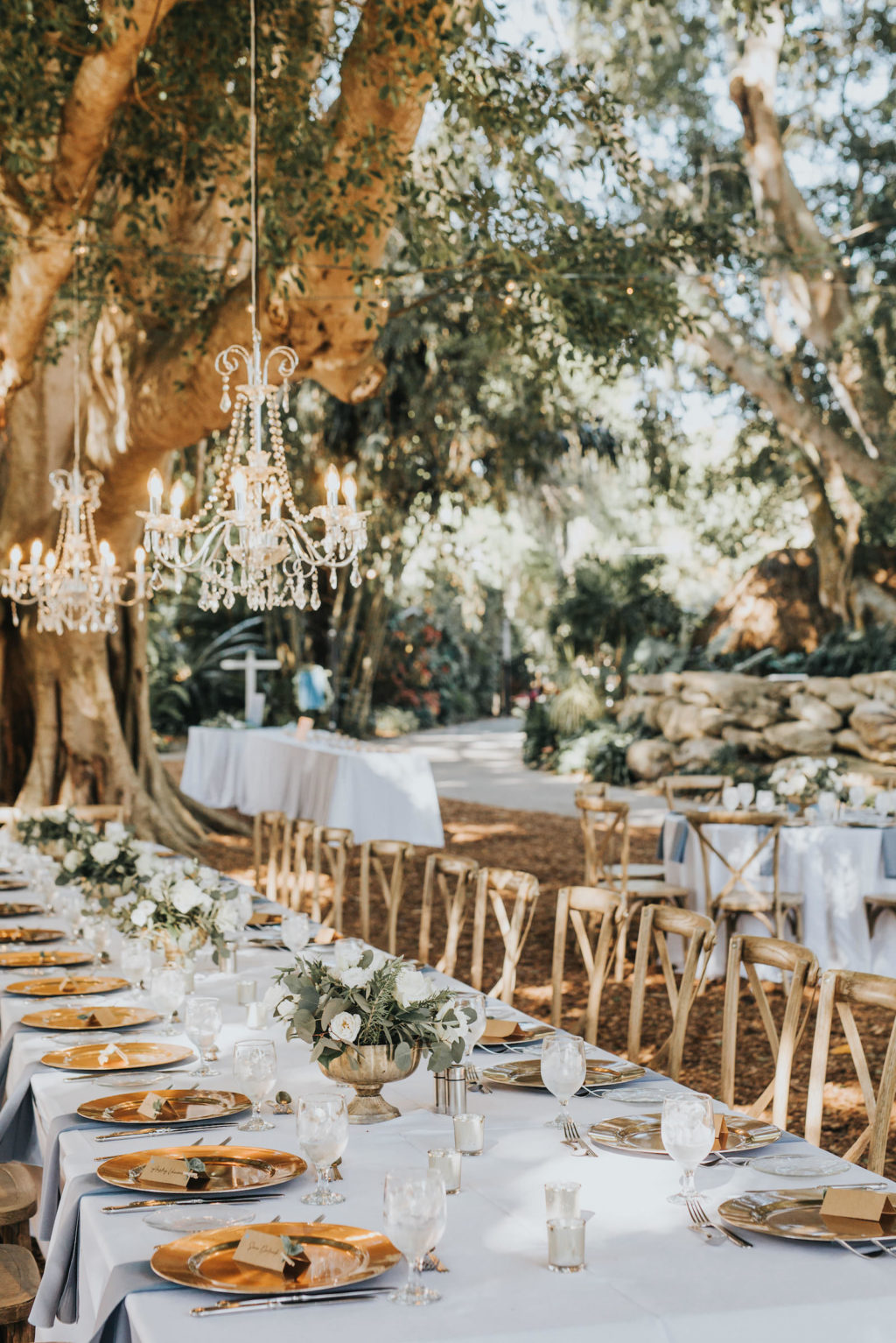 Romantic Rustic Outdoor Garden Wedding Reception | Sarasota Marie Selby Botanical Gardens | Gold Chargers and French Country Wooden Reception Chairs | Crystal Chandeliers Hanging from Trees | Sarasota Wedding Planner Taylored Affairs