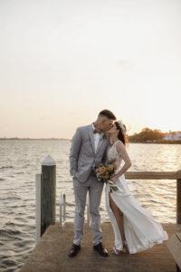 Boho Bride and Groom Sunset Wedding Portrait | Sarasota Waterfront Wedding Venue | Planner Kelly Kennedy Weddings and Events | Photographer Alisa Sue Photography