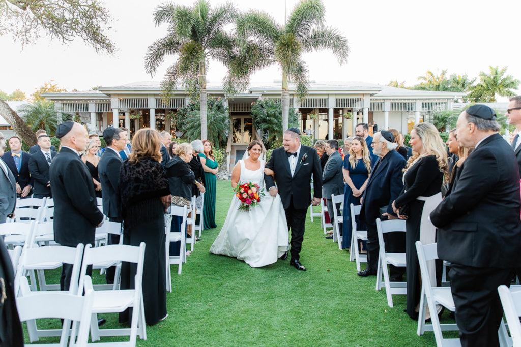 Florida Bride Walking Down the Wedding Ceremony Aisle, Jewish Wedding | Tampa Bay Wedding Outdoor Garden Venue The Resort at Longboat Key Club