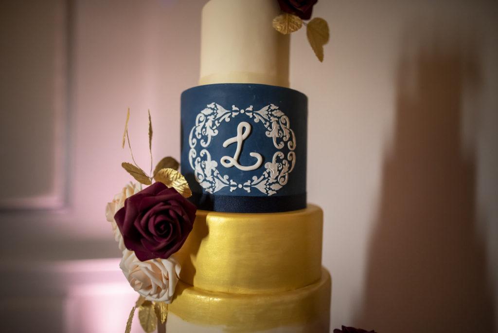Six Tier Navy Blue, White, and Gold Round Wedding Cake with Monogram   Dessert Ideas
