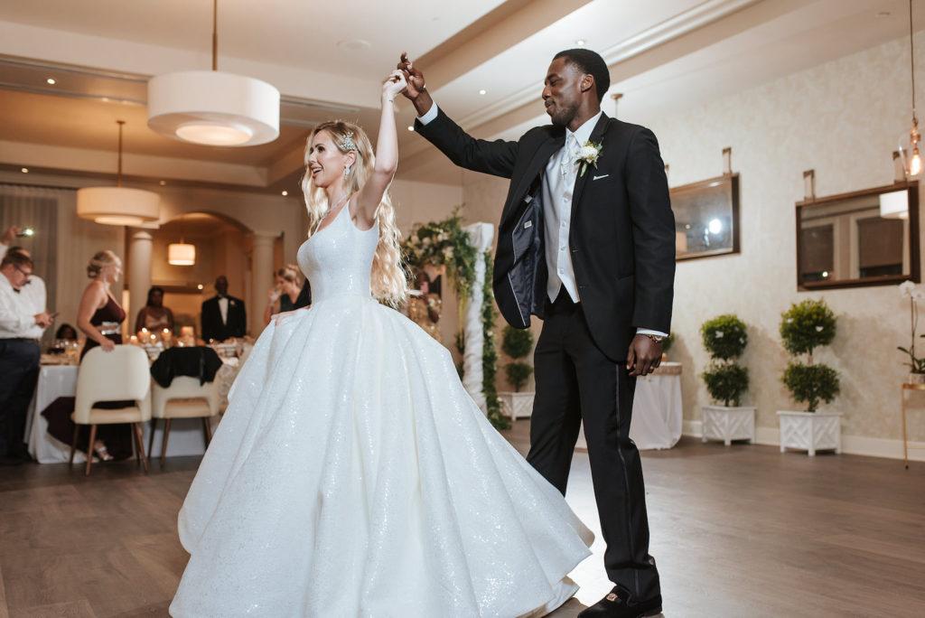 Timeless Elegant Bride Wearing Full Skirt Ballgown Wedding Dress First Dance with Groom   Tampa Bay Wedding Venue Westshore Yacht Club