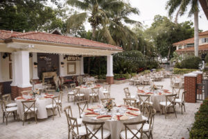 Outdoor Boho Wedding Reception with Rustic Wooden French Country Chairs, Round Tables with Cream Linens and String Lights | Tampa Bay Rental Company Kate Ryan Event Rentals | Sarasota Wedding Venue Palmetto Riverside Bed and Breakfast