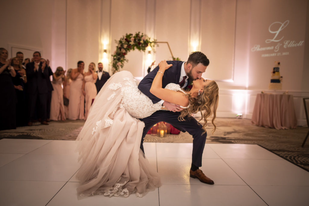 Bride and Groom First Dance with White Dance Floor   St. Pete Wedding Venue The Karol   Dance Floor Kate Ryan Event Rentals