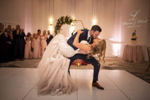 Bride and Groom First Dance with White Dance Floor | St. Pete Wedding Venue The Karol | Dance Floor Kate Ryan Event Rentals