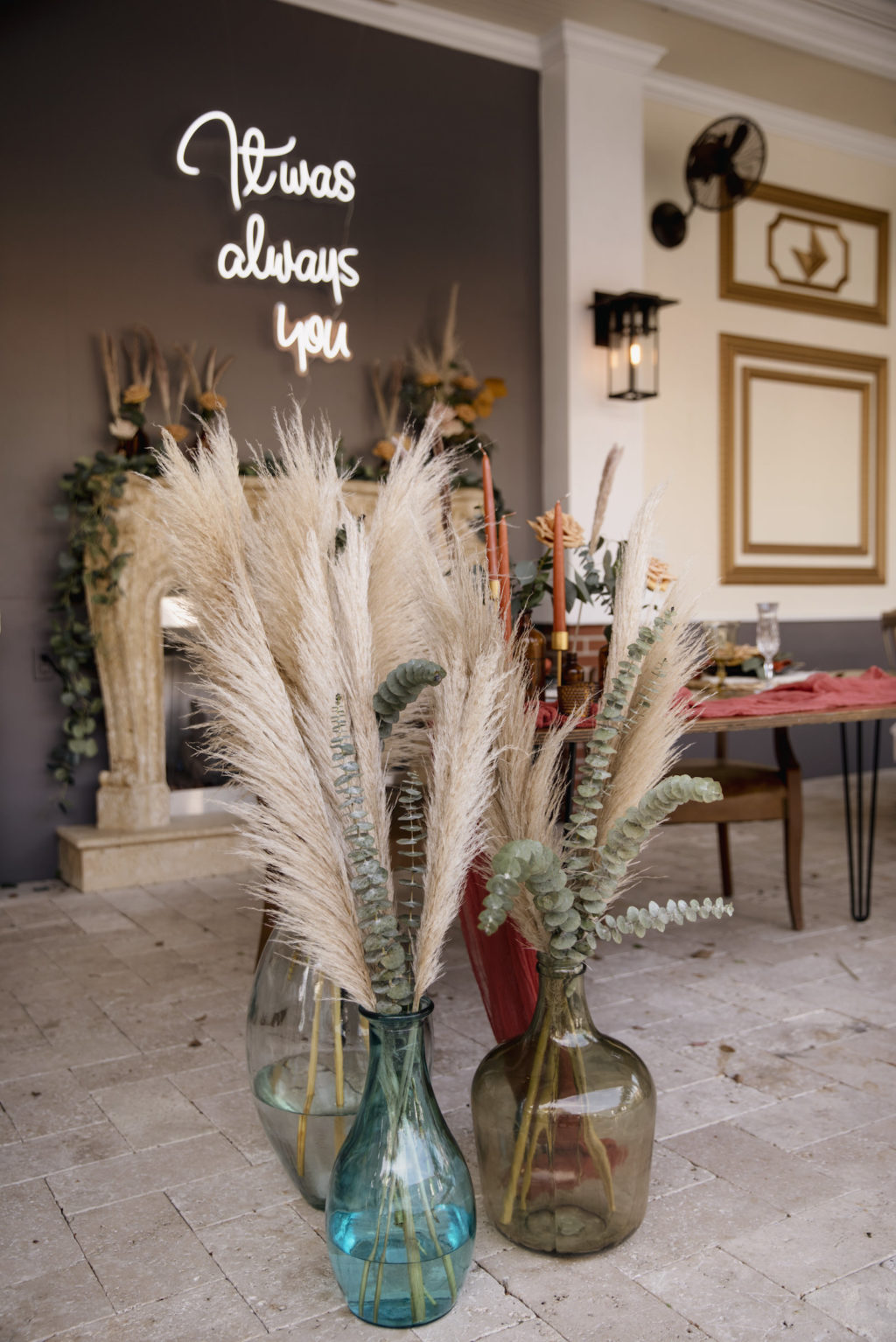Neon Sign and Pampas Leaves in Large Clear Vases with Greenery   Boho Wedding Reception Décor Ideas