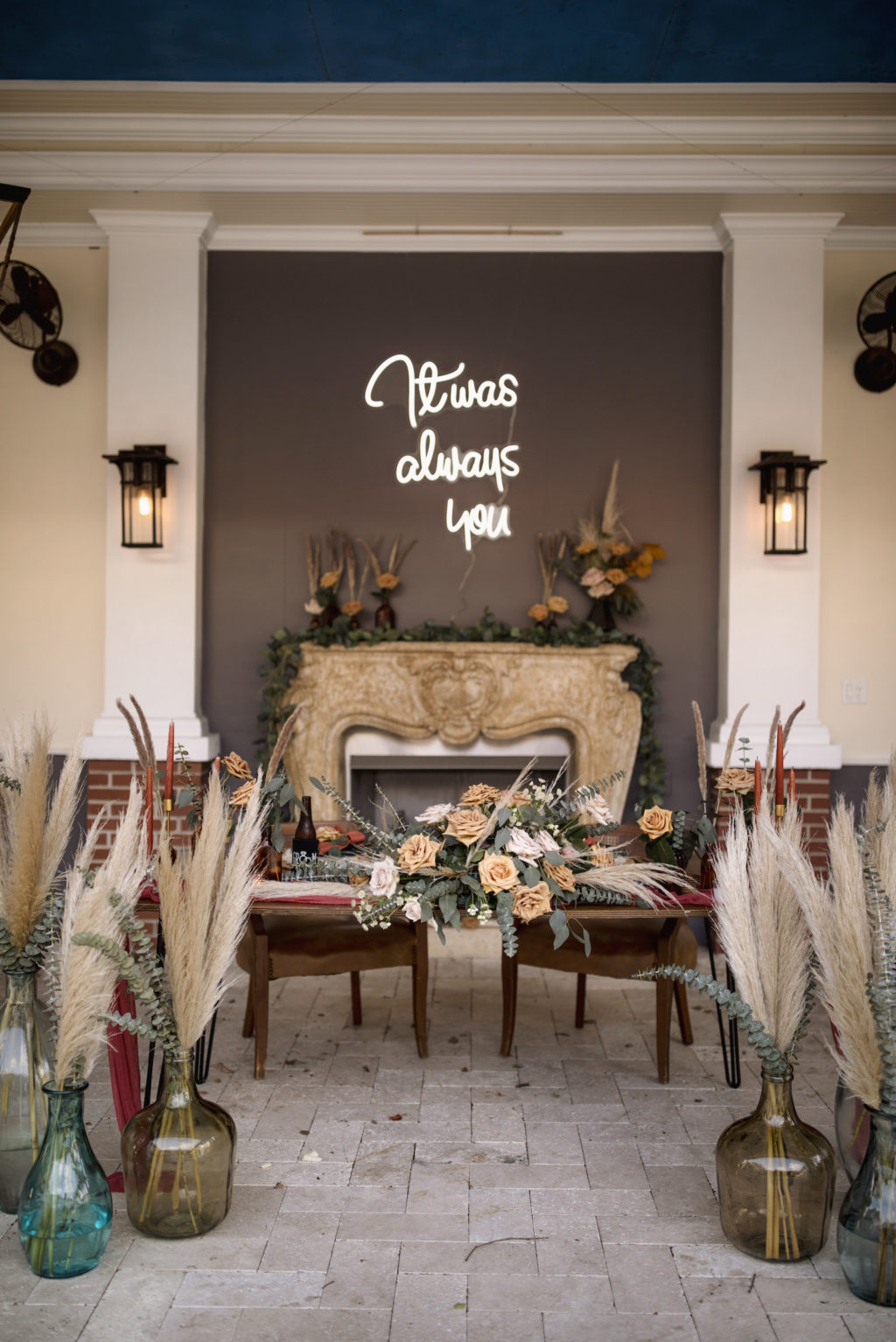 Wedding Neon Sign and Pampas Leaves in Large Clear Vases with Greenery   Boho Wedding Reception Décor with Sweetheart Table   Kate Ryan Event Rentals   Sarasota Wedding Planner Kelly Kennedy Weddings and Events