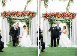Elegant Waterfront Outdoor Garden Jewish Wedding Ceremony Decor, Bride and Groom Exchanging Wedding Vows, White Folding Chairs, Tall Wooden Aisle Pedestals with Jewel Tone Floral Arrangements, Arch with White Linens and Flowers   Tampa Bay Wedding Venue The Resort at Longboat Key Club