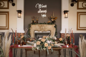 Wedding Neon Sign and Pampas Leaves in Large Clear Vases with Greenery | Boho Wedding Reception Décor with Sweetheart Table | Kate Ryan Event Rentals | Sarasota Wedding Planner Kelly Kennedy Weddings and Events