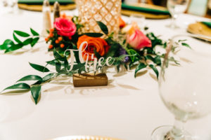 Gold Rustic Wedding Table Numbers with Floral Centerpieces | Garden Wedding Tablescape Ideas with Bright Vibrant Pink Flowers and Greenery