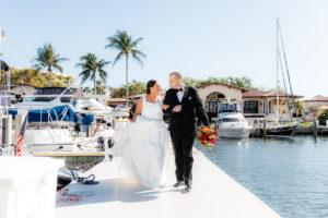 Florida Bride and Groom Walking on Boat Dock at Marina   Tampa Bay Wedding Venue The Resort at Longboat Key Club