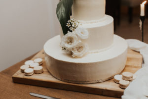 Simple Neutral Three Tier White Wedding Cake with Ivory Roses