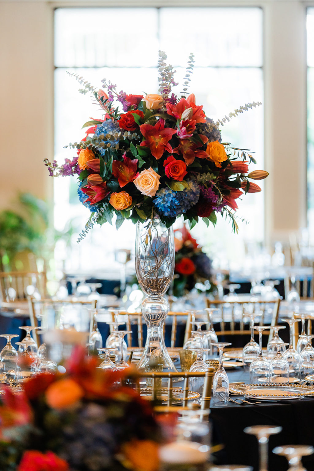 Elegant Ballroom Wedding Reception Decor, Silver Chiavari Chairs, Round Tables with Navy Blue Table Linens, Jewel Tone Tall Floral Centerpieces, Blue, Pink, Red, Orange Flowers | Tampa Wedding Venue The Resort at Longboat Key Club