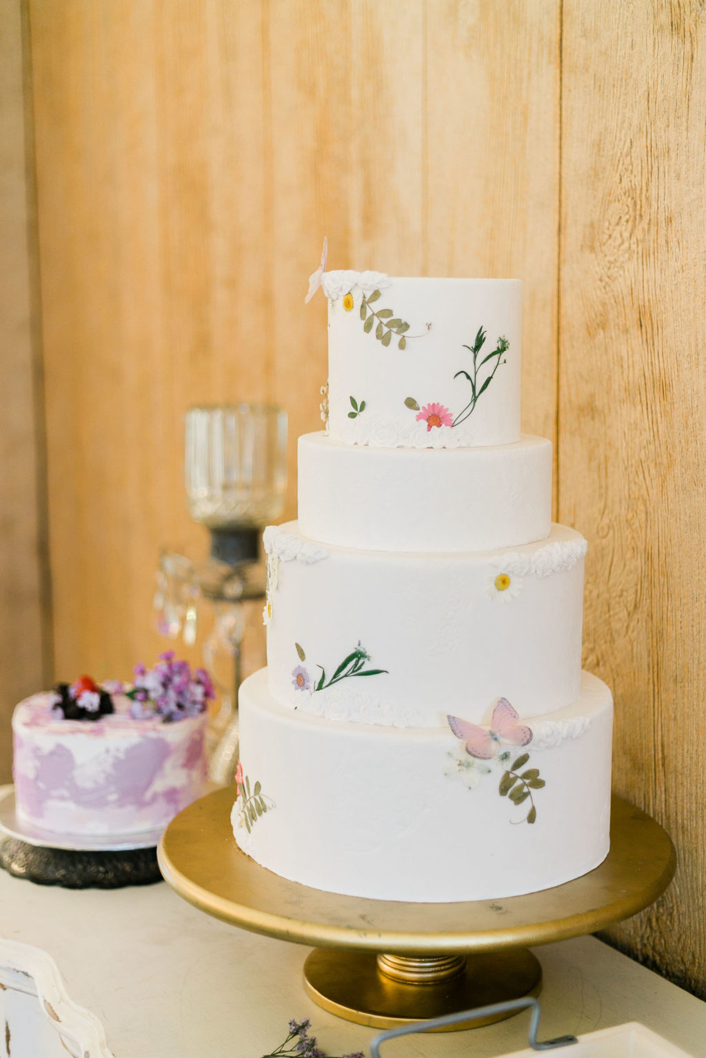 Simple White Four Tier Wedding Cake with Floral Details   Garden Inspired Wedding Cake