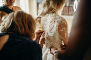 Florida Bride with Bridesmaids Helping Button Up Rhinestone Embellished Illusion Long Sleeve Wedding Dress